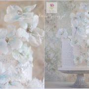 Biały tort z kwiatami na chrzest